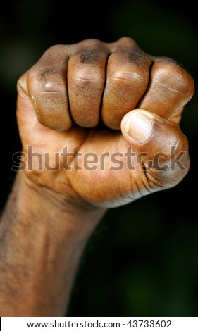 clenched fist of afro man - stock photo