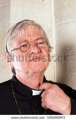 Clergyman being annoyed by the pinching priest collar of his shirt or cassock - stock photo