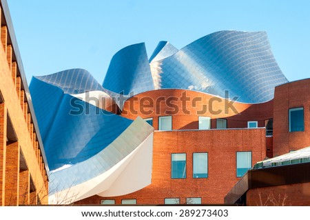 CLEVELAND, OH - FEBRUARY 28 2015: The Peter B. Lewis building, designed by renowned architect Frank Gehry, glistens in late afternoon sunlight on the campus of Case Western Reserve University. - stock photo