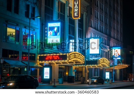CLEVELAND, OH - JANUARY 1, 2016: The marquees of the Ohio, State, and Palace theaters, the heart of Playhouse Square, Cleveland's theater district, are lit up brightly in the evening. - stock photo
