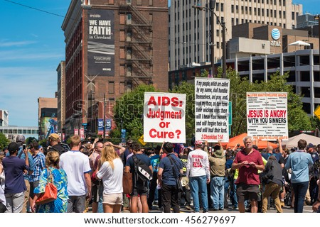 CLEVELAND, OH - JULY 20, 2016: A hard-core extremist religious group draws a crowd of the curious onlookers on Prospect Avenue during the Republican National Convention. - stock photo
