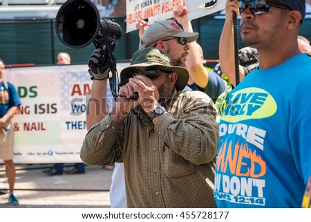 CLEVELAND, OH - JULY 20, 2016: A hard-core, far-right street preacher harangues the crowds in an impromptu rally during the Republican National Convention. - stock photo