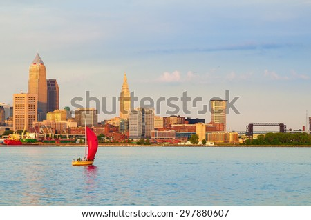 CLEVELAND, OH - JULY 24 2015: The city and port of Cleveland are seen from Lake Erie, just to the west of the mouth of the Cuyahoga. Cargo ships and pleasure craft share the water here. - stock photo