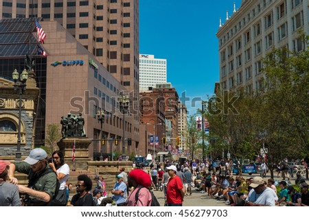 CLEVELAND, OH - JULY 20, 2016: Throngs of protesters, supporters, and the merely curious fill Public Square and Euclid Avenue on the third day of the Republican National Convention. - stock photo