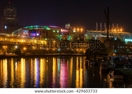 CLEVELAND, OH - MAY 28, 2016: View of Quicken Loans Arena (the Q) glowing above the Cuyahoga River. The Q will be the site of the NBA Finals and of the Republican National Convention in July. - stock photo