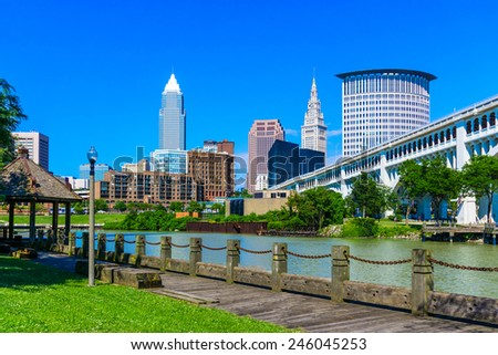 Cleveland skyline and the Cuyahoga River waterfront with bridge and wooden walkway, OH - stock photo