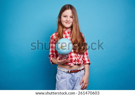 Clever girl keeping a small globe - stock photo