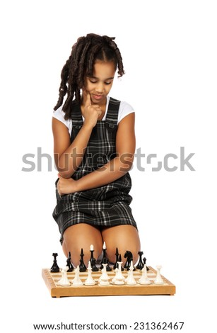 clever� girl playing chess thinking - stock photo