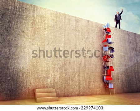 clever man try solution to climb the wall - stock photo