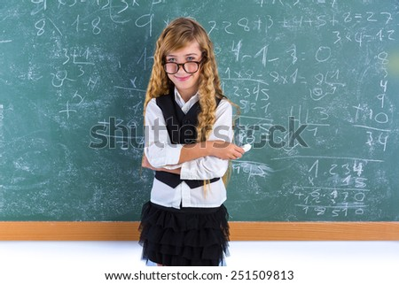 Clever nerd pupil blond girl in green board student schoolgirl - stock photo