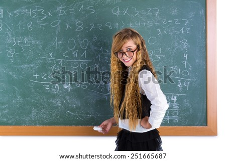 Clever nerd pupil blond girl in green chalk board student schoolgirl - stock photo