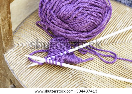 Clews and knitting needles, detail to make clothes - stock photo