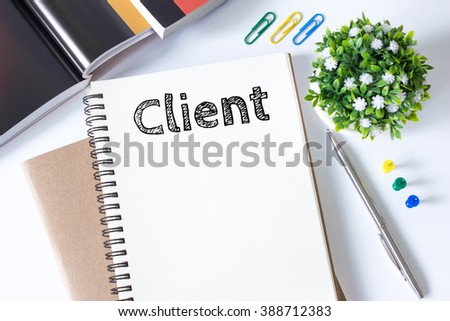 Client, Text message on white paper book on white desk / business concept - stock photo