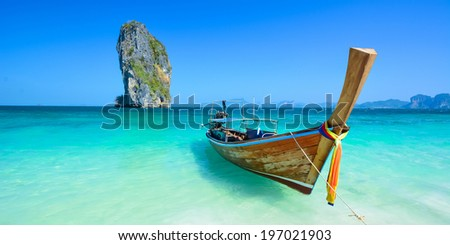 Cliff and boat in the amazing beach in tropical island in Krabi, Phuket, Thailand - stock photo