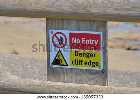 Cliff edge danger sign - stock photo
