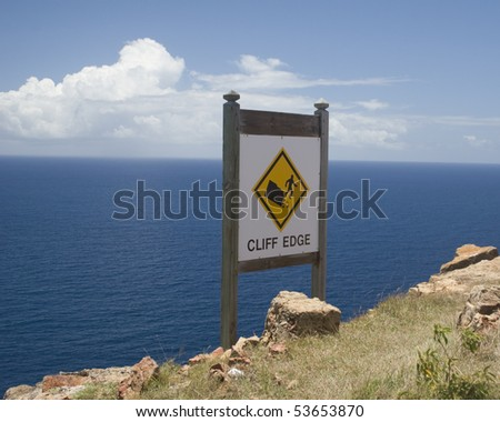 cliff edge sign at Shirley heights Antigua - stock photo