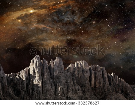 cliff in lunar landscape under a starry night sky - stock photo