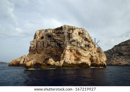 Cliff in the Mediterranean Sea. Sardinia. Italy - stock photo