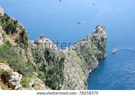 Cliff on Alanya coastline - stock photo