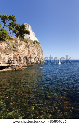 Cliff on the coast of Dubrovnik in Croatia - stock photo