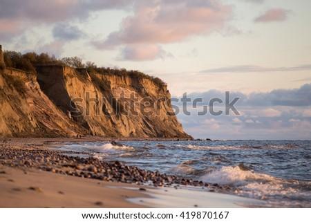 cliff on the sea coast, steep coast - stock photo