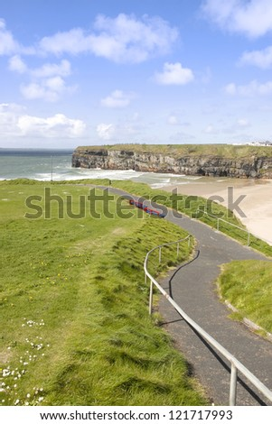 cliff walk with a  beautiful view over the Ballybunion beach and cliffs on the Atlantic coast in Ireland - stock photo