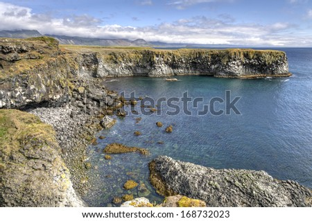 Cliffs and basalt rocks near Arnarstapi, Snaefellsnes peninsula in Iceland - Snaefellsnes is a peninsula situated to the west of Borgarfjordur, in Iceland. This area has been designated National Park. - stock photo