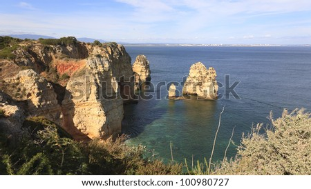 cliffs at ponta da piedade cape, Lagos, algarve portugal - stock photo