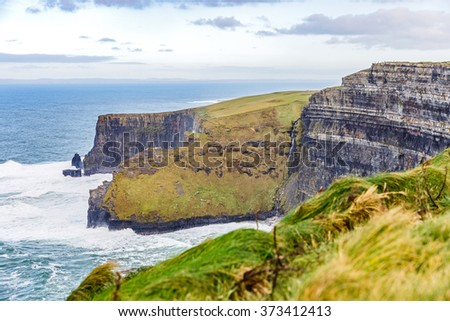 Cliffs of Moher Tourist Attraction in Ireland - stock photo