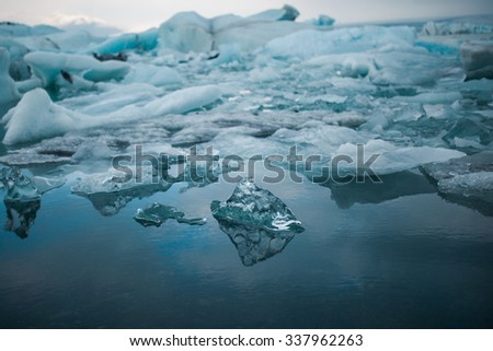 Climate change and global warming. Glacier melting in Iceland. Floating icebergs in Jokulsarlon lagoon. - stock photo