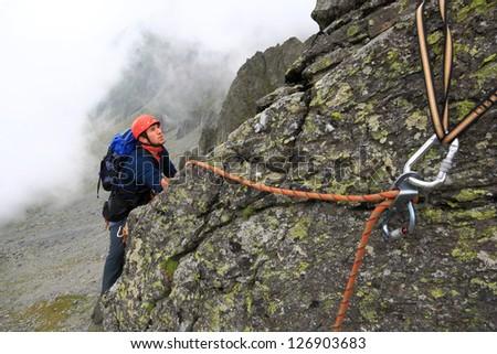 Climber and gear during summer, Fagaras mountains, Romania - stock photo