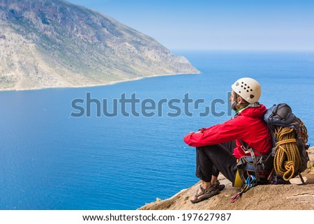 Climber have a rest on the top of the Mountain  - stock photo