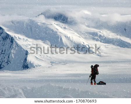 Climber in a snow storm ,Alaska - stock photo