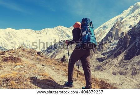Climber in Himalayan mountain - stock photo