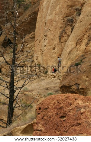 Climber on belay starts his ascent     at Smith Rock State Park, in Central Oregon - stock photo