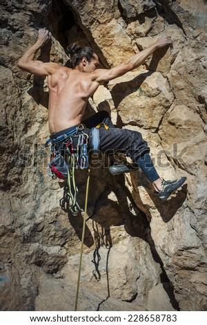 climber on the rock like a stone. - stock photo