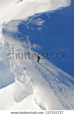 Climber on the snowy route to Mont Blanc sumit - stock photo