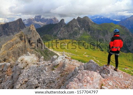 Climber on top of Averau peak, Dolomite Alps, Italy - stock photo