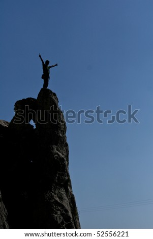 climber on top of rock - stock photo