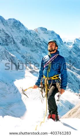 Climber reaching the summit, Nepal Himalayas - stock photo