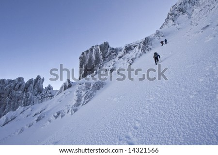 Climbers ascending a snow slope on Mount Thielsen - stock photo