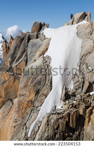 Climbers ascending to the Aiguille du Midi in the French Alps. - stock photo