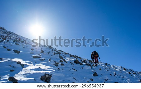 climbers at the mountain summit in scenic Tian Shan range in Kyrgyzstan, Ala-Archa national park - stock photo