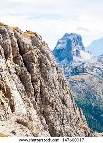 Climbers on via ferrata in Dolomites - stock photo