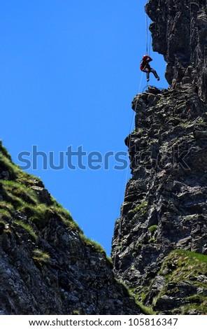 Climbing alpinist - stock photo