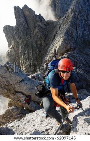 Climbing alpinist on Koenigsjodler route, Austria - stock photo