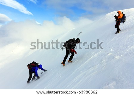 Climbing alpinists - stock photo