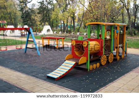 climbing frame in the shape of a train shallow DOF - stock photo