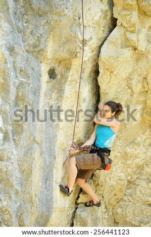Climbing girl in Crimea - stock photo
