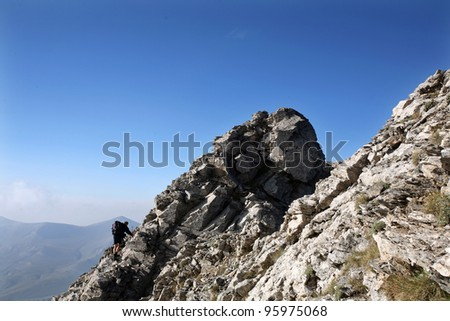 Climbing Mount Olympus. Mount Olympus is highest mountain in Greece at 2917 meters. (Mount Olympus is the home of the Twelve Olympians, the principal gods in the Greek pantheon) - stock photo